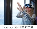 woman wearing virtual reality...   Shutterstock . vector #699569857