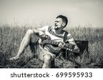 the young man on the field  the ... | Shutterstock . vector #699595933