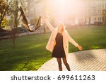 cheerful woman jumping and... | Shutterstock . vector #699611263