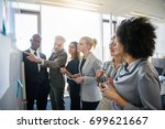 diverse group of focused work... | Shutterstock . vector #699621667