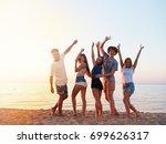 group of friends having fun on... | Shutterstock . vector #699626317