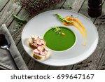 pea cream soup in a rim soup... | Shutterstock . vector #699647167