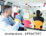 people waiting for their turn | Shutterstock . vector #699667597