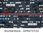 top view of numerous cars in a... | Shutterstock . vector #699673723