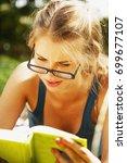 young beautiful girl is... | Shutterstock . vector #699677107