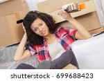 exhausted woman with packages... | Shutterstock . vector #699688423
