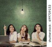 three pretty female high school ... | Shutterstock . vector #699709153