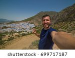 tourist observing a panoramic... | Shutterstock . vector #699717187