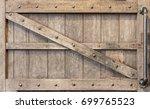 wooden door with holder. | Shutterstock . vector #699765523