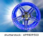 blue car wheels on a blurred