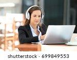 portrait of a serious executive ... | Shutterstock . vector #699849553