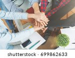 friends hi fiving each other at ... | Shutterstock . vector #699862633