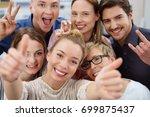 six smiling  happy work... | Shutterstock . vector #699875437