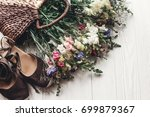 beautiful wildflowers in wicker ... | Shutterstock . vector #699879367