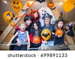 big  family in costumes has fun ... | Shutterstock . vector #699891133