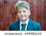 scruffy schoolboy in the...   Shutterstock . vector #699980143