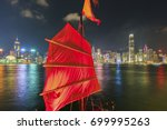 tourist ship in victoria harbor ... | Shutterstock . vector #699995263