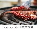 grilled octopus | Shutterstock . vector #699999457