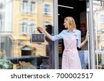 smiling young florist in aorn...   Shutterstock . vector #700002517