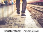 bacpack walking in train... | Shutterstock . vector #700019863