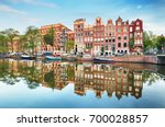 canal houses of amsterdam at... | Shutterstock . vector #700028857