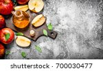 apple cider vinegar with fresh... | Shutterstock . vector #700030477