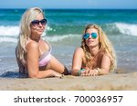 happy girls at the sea | Shutterstock . vector #700036957