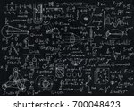Small photo of Blackboard inscribed with scientific formulas and calculations in physics.