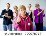 group of seniors doing exercises | Shutterstock . vector #700078717