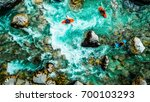 whitewater kayakers on the... | Shutterstock . vector #700103293