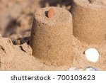 sand castle pillar with red...