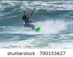 kiteboarder enjoy surfing on a... | Shutterstock . vector #700153627