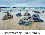 Small photo of Closeup of lugworm cast on the sandy beach