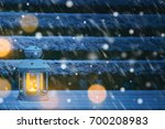 christmas lantern with snowfall ... | Shutterstock . vector #700208983