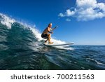 muscular surfer with long white ... | Shutterstock . vector #700211563