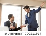 angry strict dissatisfied boss... | Shutterstock . vector #700211917