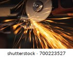 angle grinder throwing sparks. | Shutterstock . vector #700223527