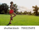 young girl is running on green... | Shutterstock . vector #700225693
