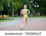 the child is an acrobat in the ... | Shutterstock . vector #700285627