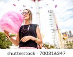 young woman standing with pink... | Shutterstock . vector #700316347