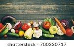 fresh vegetables on a wooden... | Shutterstock . vector #700330717