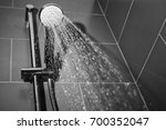 under the shower jet image... | Shutterstock . vector #700352047