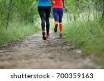 two running sportswomen in... | Shutterstock . vector #700359163
