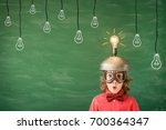 bright idea  funny child in... | Shutterstock . vector #700364347
