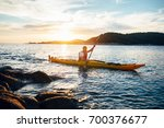 man paddling the kayak at... | Shutterstock . vector #700376677