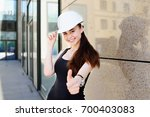 young cute girl in a... | Shutterstock . vector #700403083