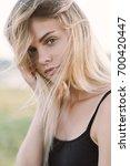 sensual portrait of a beautiful ...   Shutterstock . vector #700420447