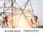 the workers of the pylon  | Shutterstock . vector #700431937