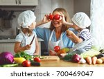 healthy eating. happy family... | Shutterstock . vector #700469047