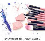 make up brushes and crushed... | Shutterstock . vector #700486057